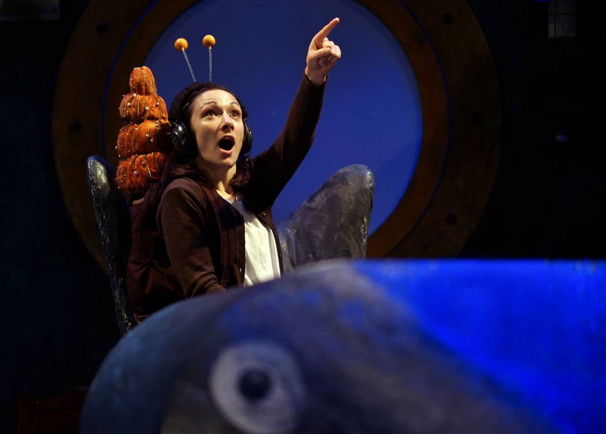 a girl with a smail outfit on pointing snail and the whale theatre review